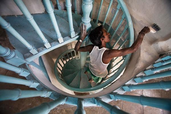 ''A man painting a staircase in India,'' 2007, photograph by Jorge Royan